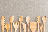Border of wooden kitchen necessities — Stock Photo