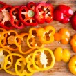 Sliced Red and Yellow Bell Peppers on Wooden Board — Stock Photo #69908055