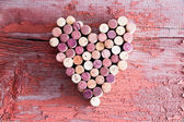 Plenty of Wine Bottle Corks in Heart Shape — Stock Photo