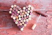 Corks in Heart Shape and Bottle Opener on Table — Stock Photo