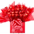 Colorful red gift of chocolate flowers — Stock Photo #70652985