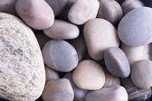 Background texture of smooth oceanic stones — Stock Photo