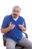 Bearded Guy Sitting on Chair Explaining Something — Stock Photo