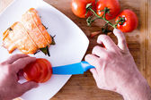 Chef plating up a gourmet salmon dinner — Stock Photo