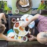 Man and woman enjoy an outdoor Turkish breakfast — Stock Photo #72753561