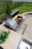 Healthy outdoor living cooking in a summer kitchen — Stockfoto