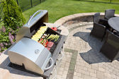 Grilling food on an outdoor gas barbecue — Stock Photo