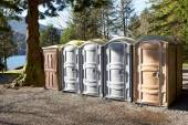 Portapotty in a park yard for public convenience — Stock Photo