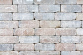 Background texture of a tumbled brick wall — Stock Photo