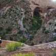 Girl Hiker Looking at Brimhall Natural Bridge, Capitol Reef Nat — Stock Photo #74911161