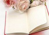 Notebook with flowers — Stock Photo