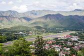 Airport in mountain town — Stock Photo