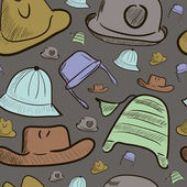 Seamless texture with color caps and hats — Vettoriale Stock