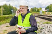 Railroad maintenance worker talking on the phone — Stock Photo