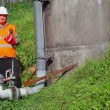 Worker with cell phone at outdoor near pipe — ストックビデオ #55717487