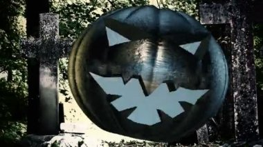 Abstract pumpkin head over the cemetery — Stock Video