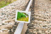 Tablet PC on Rails — Stock Photo