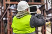 Engineer filmed with tablet PC in factory — Stock Photo