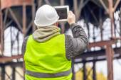 Engineer with tablet PC at factory — Stock Photo