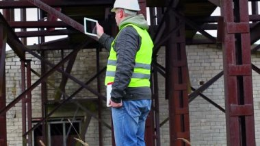 Engineer filmed with tablet PC in factory — Stock Video