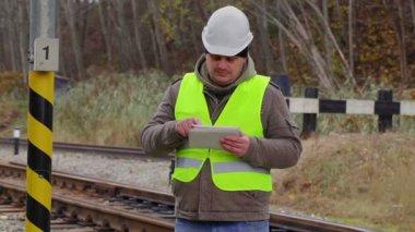 Railway engineer working with tablet PC near railway — Stock Video