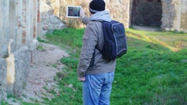 Hiker filmed with tablet PC in ruins — Stock Video