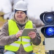 Railway employee with tablet PC near the warning lights — Stock Photo #59284927