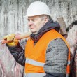 Worker with sledge hammer near the wall — Stock Photo #70269103