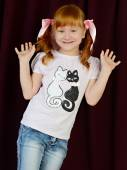 Portrait of red-haired girl in a shirt and jeans — Stockfoto