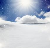 Background of cold winter landscape with snow, blue sky and sunl — Stock Photo