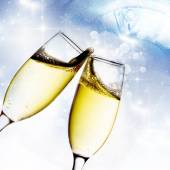 Glasses with champagne against holiday lights — Stock Photo