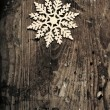 Snowflakes on grunge wooden background. Winter holidays concept — Stock Photo #59029841