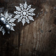 Snowflakes on grunge wooden background. Winter holidays concept — Stock Photo #59029983