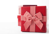 Red gift boxes and Christmas decoration — Stock Photo