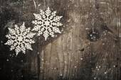 Snowflakes on grunge wooden background. Winter holidays concept  — Stock Photo