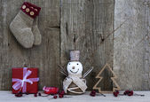 Christmas decorations on rustic wooden background — Stock Photo