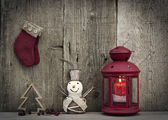 Christmas decorations on rustic wooden background — Stockfoto