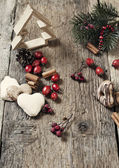 Christmas decorations on rustic wooden background — Foto de Stock