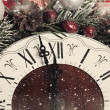 Christmas clock and fir branches covered with snow — Stock Photo #59170257