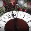 Christmas clock and fir branches covered with snow — Stock Photo #59170373