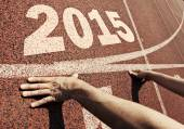 Happy new year 2015 - hands on starting line  — Stock Photo