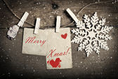 Vintage Christmas decorations and cards hanging on clotheslines — 图库照片