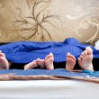 Four pairs of legs of the happy family in bed - father, mother a — Stock Photo #69430937