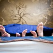 Four pairs of legs of the happy family in bed - father, mother a — Stock Photo #69431195