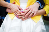 Newly wed couple embracing - focus on hands with wedding rings — Stock Photo