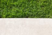 Green lawn and concrete — Stock Photo