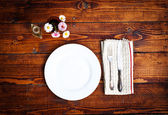 Table setting for two with empty plates - rustic wooden table — Stockfoto