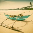 Untouched tropical beach with fishing boat in Sri Lanka — Stock Photo #74969779