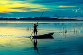 Beautiful sky and Silhouettes of fisherman. — Stock Photo