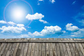 Beautiful sky with clouds and wood floor. — Stock Photo